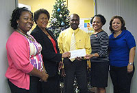 Treasury staffers present their donation to DCFS Director Deanna Look Loy. (L-R) Treasury's Jairia Barton; Mrs. Look Loy; Thoywell Facey (Treasury), DCFS Disaster Coordinator Lynda Mitchell and Treasury staff member Gladys McLean.